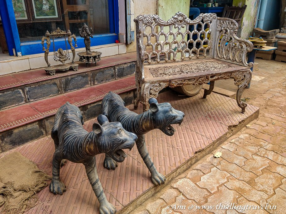 Life-sized tigers and metal antique furniture in one of the Karaikudi antique shops