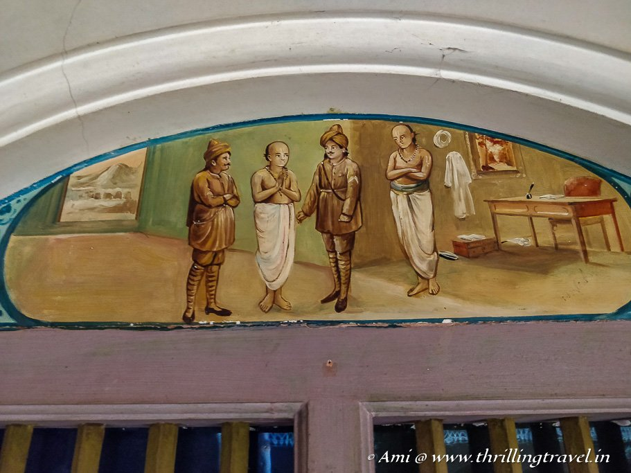 Story murals over the windows in Athangudi Palace