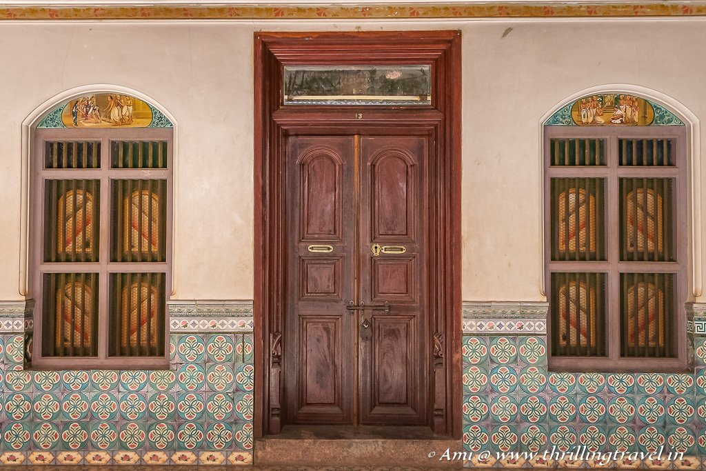 The doors and painted windows within Athangudi Palace