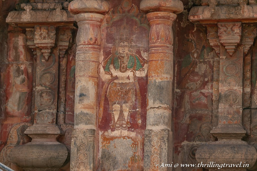 Faded murals along the facade of the Airavatesvar Temple