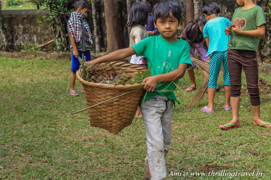 Kids involved in their weekly cleaning at the Mawlynnong church