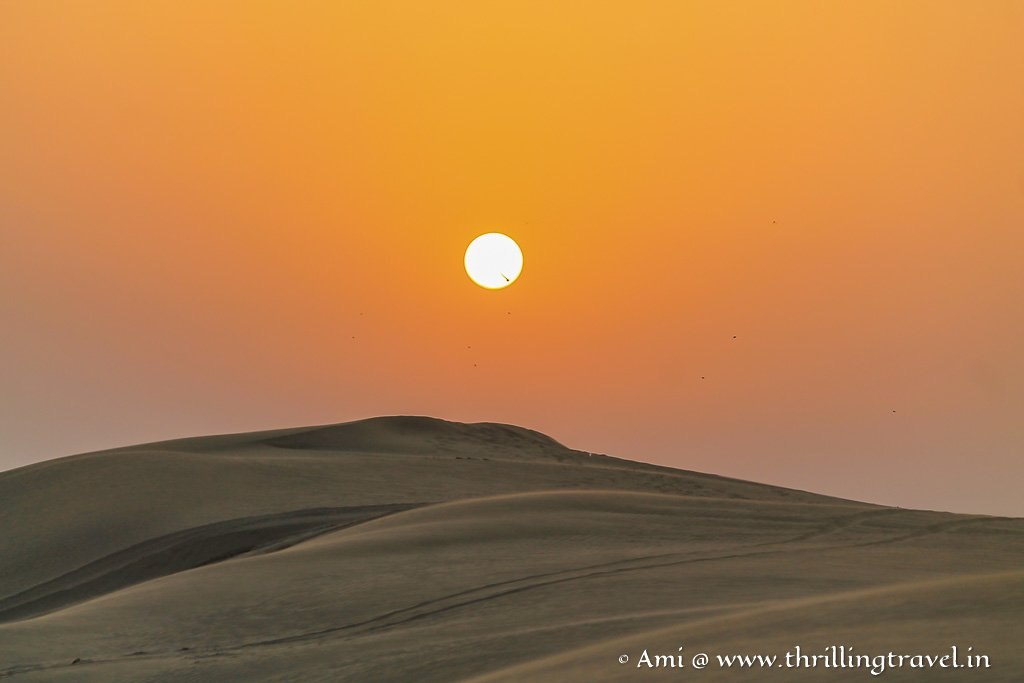 The mesmerizing sunset over the sand dunes - one of the must-do things in the Jaisalmer Desert Camps