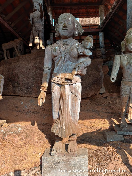 A lady with a kid - Bhuta idol at the Heritage village in Manipal