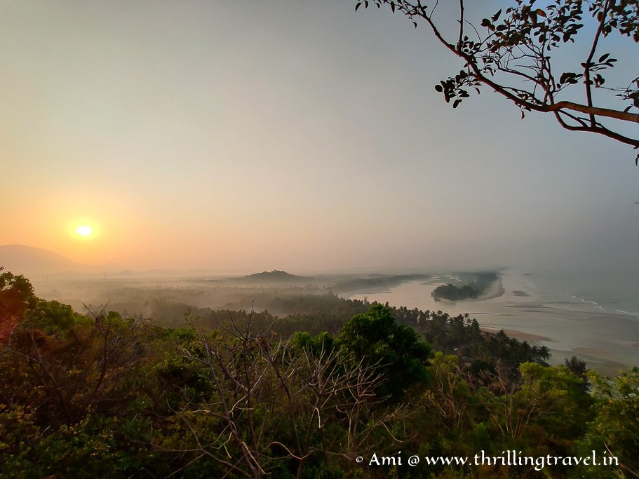 A wide angle shot of the sunrise over Byndoor - taken at Kshitija Nesara Dhama view point