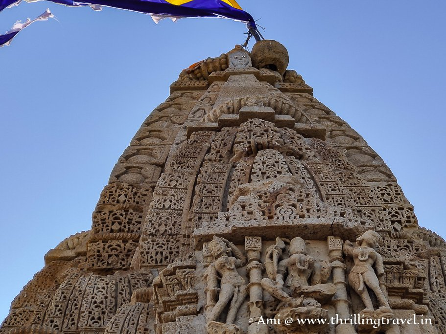 Close of the Nagara styled spire with the mysterious face and the carving of Rukmini Devi herself.