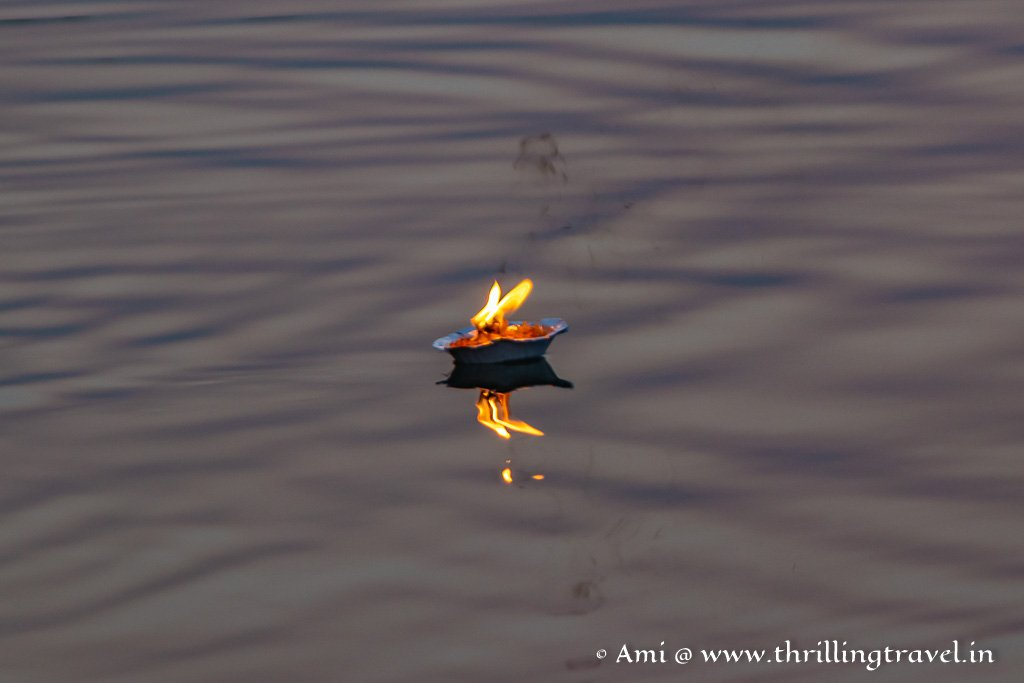 A floating diya lit in the morning at the Gomti Ghats Dwarka