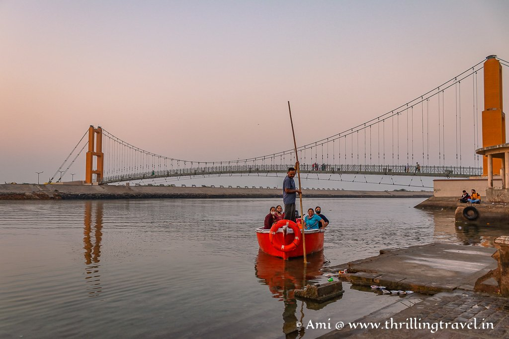 Boating on Gomti River near the Sudama Setu bridge