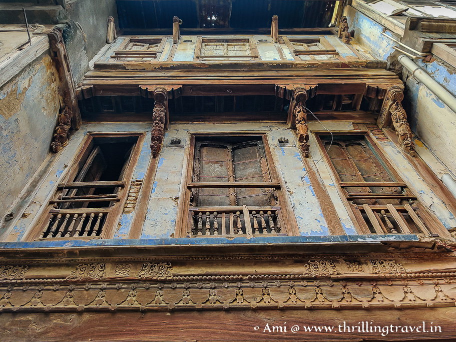 A glimpse of the Burma teak wood work on one of the abandoned homes