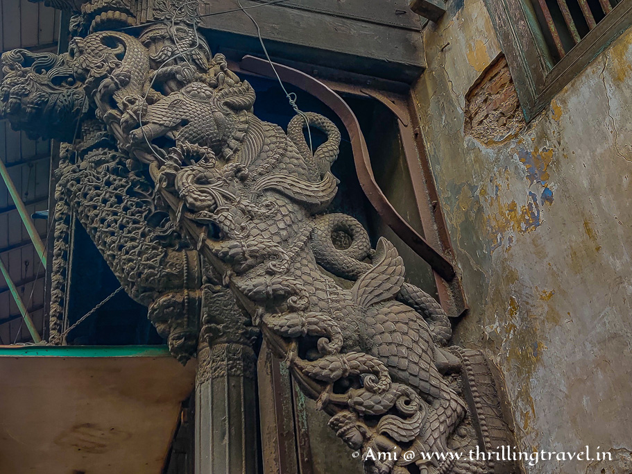 Close up of the wooden brackets that showcase the Chinese designs