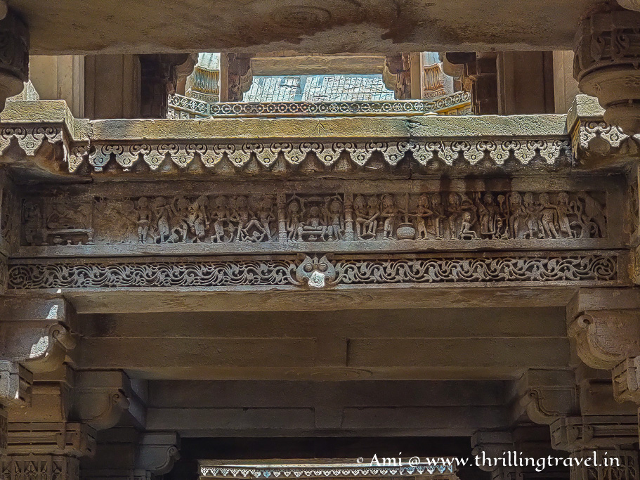Carving of a scene with the King depicted on the left hand side
